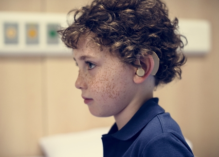 Young boy with hearing aid