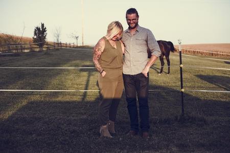 Happy caucasian couple in a farm Stock Photo - 109590617
