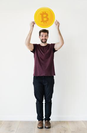White man holding bitcoin