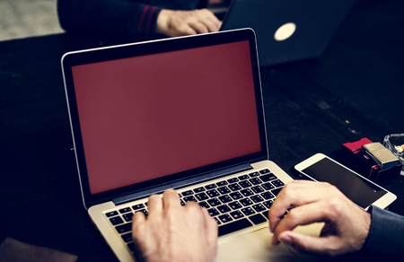 Closeup of hand with computer laptop background Stock Photo