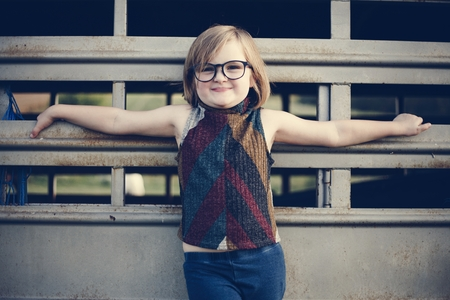 A young girl is having fun in the farm Фото со стока