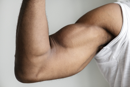 Closeup of a black person's muscular arm 스톡 콘텐츠