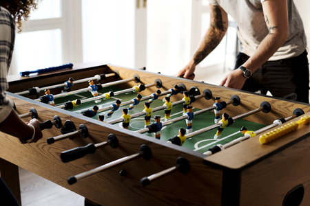 People playing table football Stock Photo
