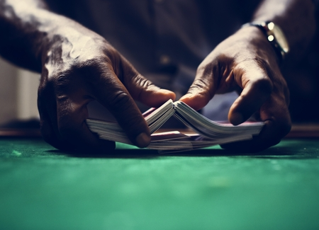 Dealer shuffling a deck of cards in casino Banco de Imagens