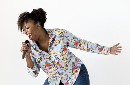 Black passionate woman vocalist singing karaoke Foto de archivo