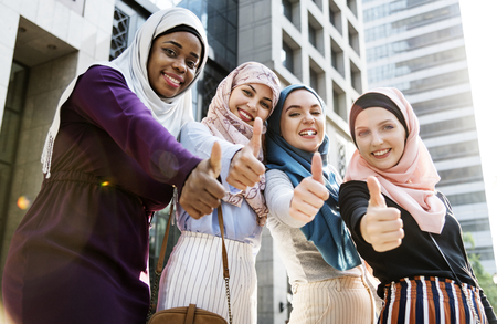 Muslim women showing thumbs up Imagens
