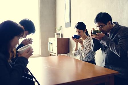 Japanese business people drinking sake
