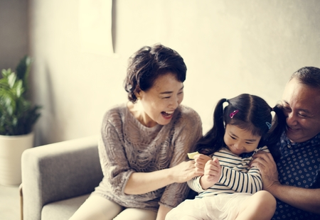Asian family grandparent and niece playing togetehr 스톡 콘텐츠