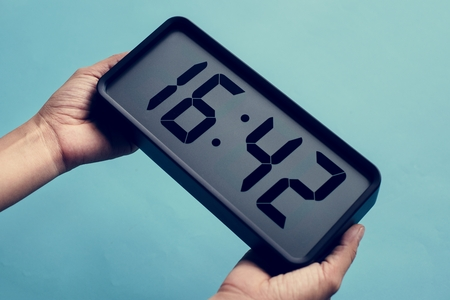 Digital clock on blue background Stock Photo - 113204289