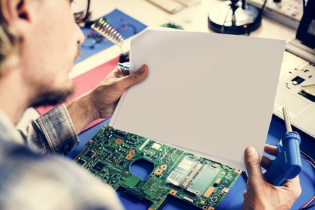 Technicians working holding blank paper