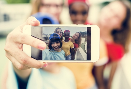 A diverse group of women taking selfie together