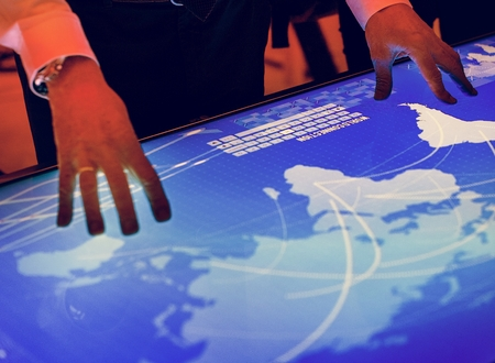 Hands touching a cyber space table screen