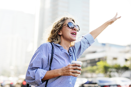 Woman wave for a cab Stock Photo
