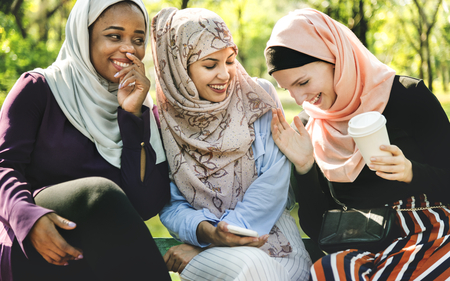 Muslim women spending time together Stock Photo