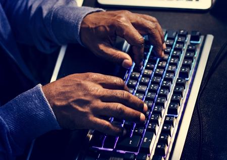 Closeup of hands working on computer keyboard Banco de Imagens