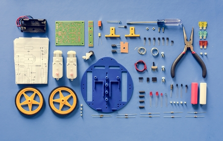 Electronics tools equipments flat lay on blue background 写真素材