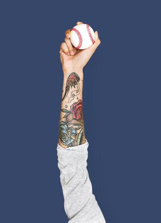 Hand holding a baseball Reklamní fotografie