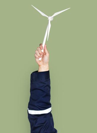Hand holding a wind turbine 스톡 콘텐츠