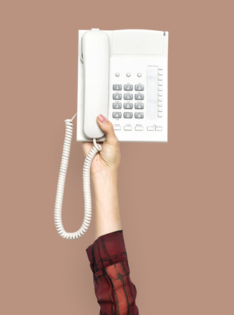 Hand holding a telephone Imagens - 115663217