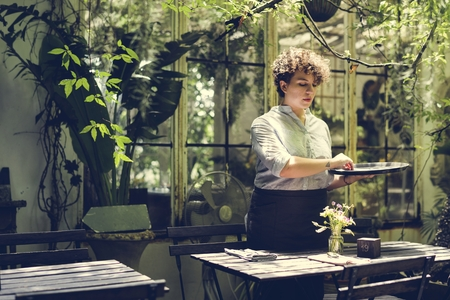 Woman working in a gardening shop 写真素材