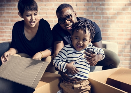 Family unpacking together in new place Stockfoto