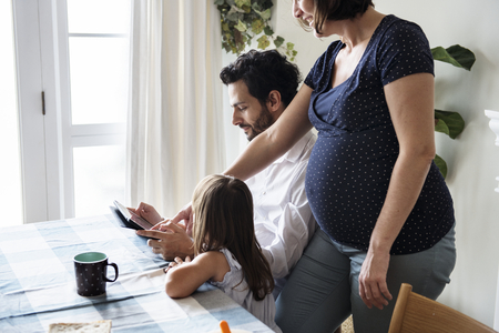 Family using a digital tablet together Stock Photo