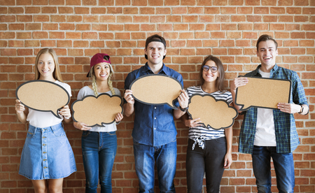 Happy young adults holding up copyspace placard thought bubbles Stok Fotoğraf