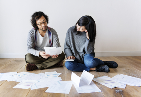 Couple managing the debt Stockfoto