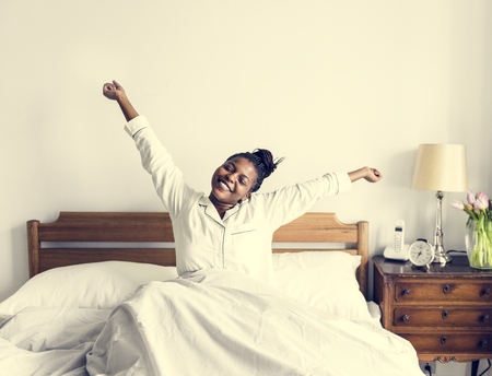 A woman waking up 写真素材