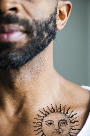 Closeup of collar bone tattoo of a man