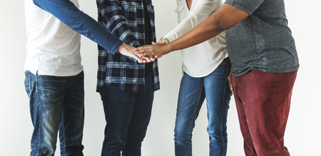 Diverse people joining hands together teamwork and community concept Stock Photo
