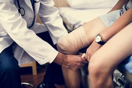 Doctor assisting a patient Reklamní fotografie - 109571038
