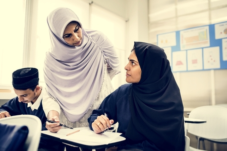 diverse muslim children studying in classroom Stock Photo