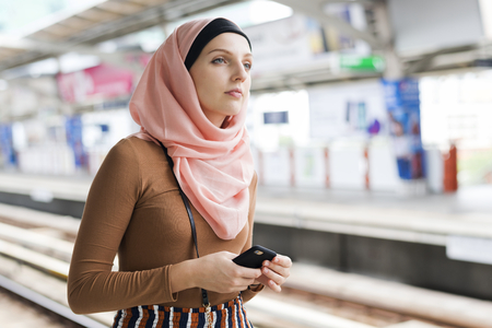 Muslim woman waiting for a train