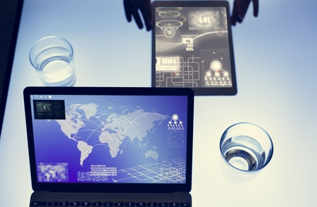 Hands using tablet on a cyber space table