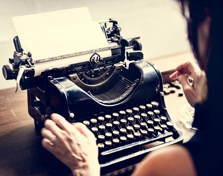 Closeup of hands typing retro vintage typewriter