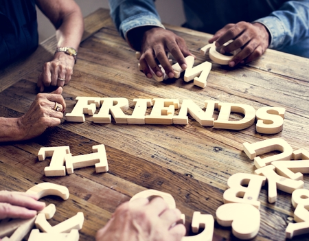 A wooden alphabet friends word on the table