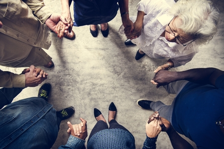 Group of diverse hands holding each other support together teamwork aerial view Stockfoto