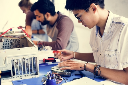 Group of people working at eletronic repair shop