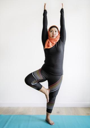 Muslim woman practicing yoga