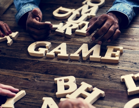 A wooden alphabet word game on wooden table Stockfoto