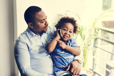 Black father enjoy precious time with his child together happiness Stock Photo