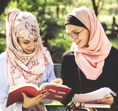 Muslim women reading books together