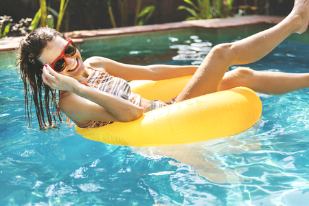 Girl cooling down in a swimming pool Archivio Fotografico