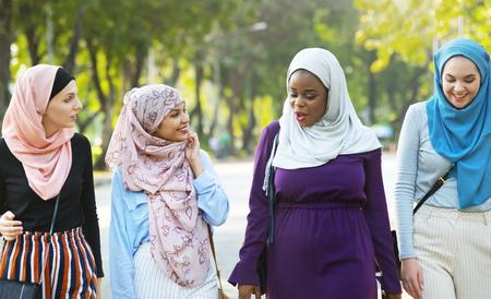 Muslim women walking together