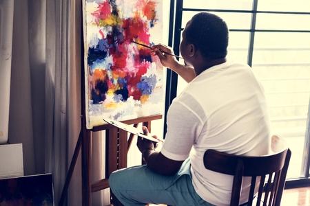 Black artist man doing his art work