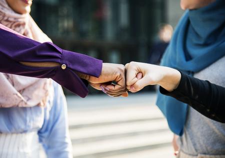 Women fist bumping each other