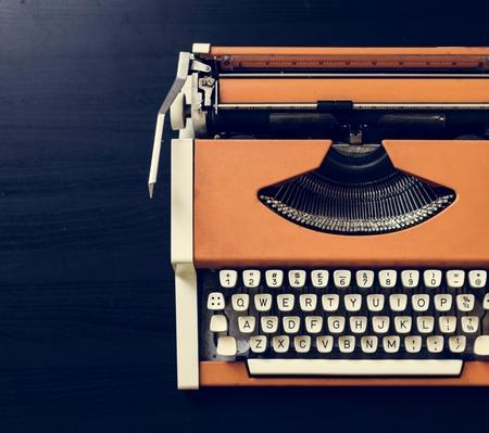 Retro orange typewriter Banco de Imagens