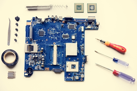 Aerial view of computer mainboard with equipments isolated on white Stock Photo