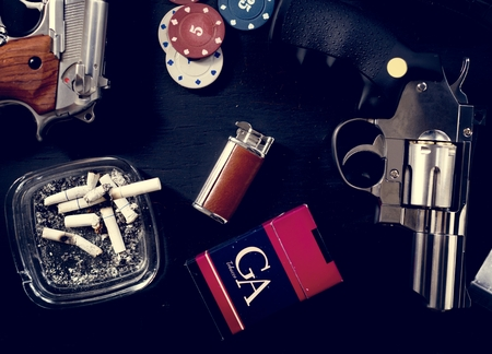 Top view of cigarettes, guns and poker chips Stok Fotoğraf